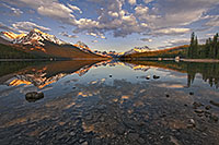 Clouds float lazily down the water as the last light hits at Maligne Lake located in Jasper National Park. - Canada Photograph