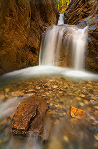 In the backcountry of the Kootenay Plains a hidden White Goat Falls cascades down a mountain side. - Rockies Photograph