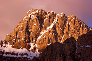 The peaks of the Bow Range with an intense glow from the rising sun. - Rockies Photograph