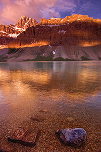 Bow Lake in Banff National Park at sunrise.  I awoke early in order to travel from Canmore to Bow Lake to capture the early sun hitting the mountains over Bow Lake. - Canada Photograph