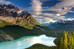 Peyto Lake in Banff National Park is known for its turquoise blue water caused by runoff from the nearby Glacier.  Most photographers will tell you to photograph this scene in the afternoon in order to maximize the reflection of the mountains on the lake.  I, however, wanted to see how it would look in the early morning.  After photographing the sunrise on Bow Lake I traveled the short distance to Peyto Lake to capture this image. - Canada Photograph