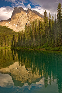 After relaxing dinner at the little restaurant that over looks this lake, I captured this photograph.  I enjoyed how the the dappled, warm afternoon sun washed over the mountain.  Emerald Lake in Yoho National Park, British Columbia, Canada. - Canada Photograph
