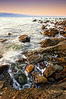 Close to the northwestern most tip of the continential United States, the waves of the Strait of the Juan de la Fuca lap against the rocks. - Pacific Photograph