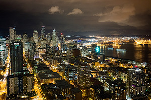 The city of Seattle stretches out into the distance from the vantage of the Space Needle. - Pacific Photograph