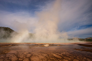 Steam from the Grand Prismatic Spring in the Middle Geyser basin rises with a warm hue from the early morning sun. - Wyoming Landscape Photograph